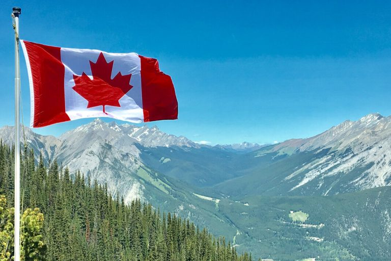 canada-flag-with-mountain-range-view-756790-cropped